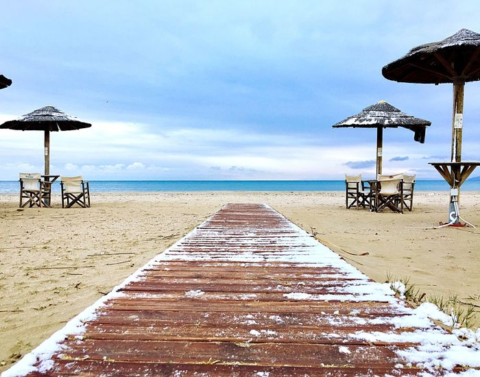 Sea Beach Horizon Over Water Water Sky Nature Tranquil Scene Sand Shore Tranquility Beauty In Nature Scenics Parasol Outdoors Beach Umbrella Day No People Cold Cold Temperature Cold Winter ❄⛄ Cold Weather Cold Morning Cold Days Snow ❄ Snow Beach