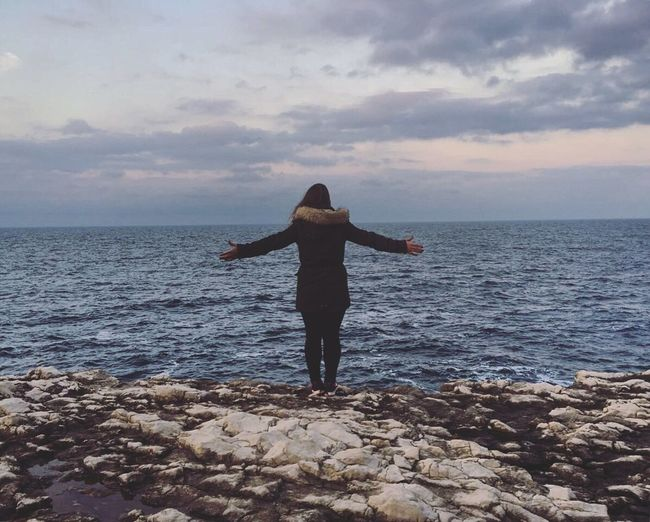 Real People Sky Sea Horizon Over Water One Person Cloud - Sky Sunset Outdoors Scenics Nature Cliff Rocky Mood Moody Sky Girl Standing My Year My View Wind Lost In The Landscape