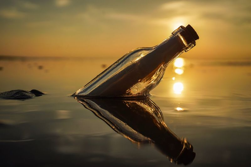 'Message in a bottle' Sunset Water Reflection Sky Close-up Sea Nature No People Outdoors Beauty In Nature Cloud - Sky Day EyeEm EyeEmBestPics EyeEm Best Shots EyeEm Gallery The Week Of Eyeem