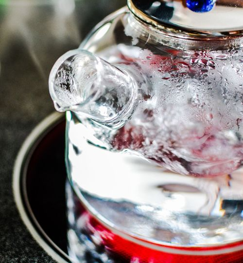 Close-up of water boiling in teapot