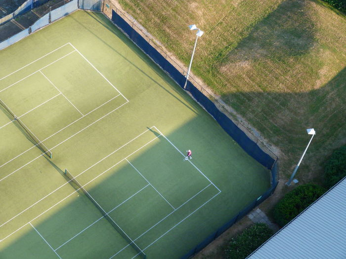 High Angle View Of Tennis Player Playing In Court