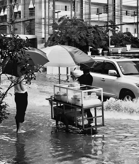 Borpenyang Adults Only Water Car Women People Men Outdoors Lifestyles Architecture Real People Building Exterior Flooding Flood Mango Streetphotography Streefood ASIA Laos Vientiane