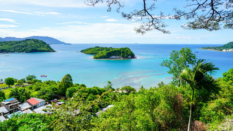 An Island at Sabang Island Indonesia with clear blue water Aceh Aceh, Indonesia INDONESIA Acheh Beauty In Nature Cloud - Sky Day Green Color High Angle View Horizon Over Water Mountain Nature No People Outdoors Sabah Sabang Island Sabangisland Scenics Sea Sky Tranquil Scene Tranquility Tree Water