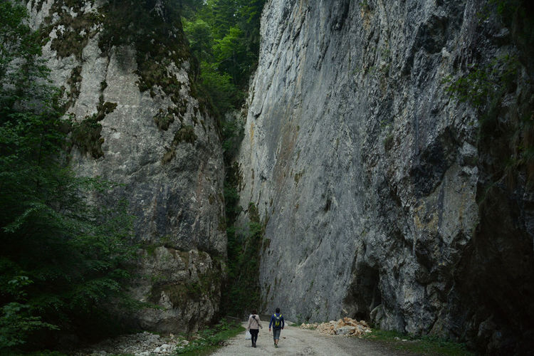 Gorge Hiking Narrow Rock Rock Formation Transylvania Travel Photography Traveling Valea Cheii Beauty In Nature Landscape Outdoors Piatra Craiului Real People Remote Solid Two People Walking Be Brave Hiking Adventures Travel Destinations Hikers Into The Unknown Into The Wild Wilderness A New Beginning