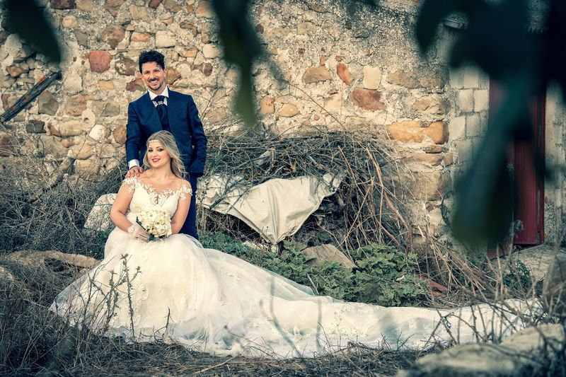 Adult Beautiful Woman Bride Celebration Couple - Relationship Emotion Event Females Love Married Men Newlywed Outdoors Positive Emotion Sitting Togetherness Two People Wedding Wedding Dress Wife Women Young Adult Young Women