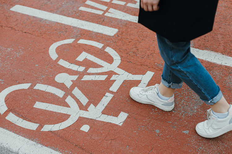 Pedestrian walking on bicycle lane