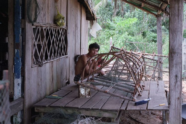 Fish hunter constructing his trap. 35mm Film Filmisnotdead Analogue Photography Film Photography People Built Structure Window Building Abandoned Day Damaged House Nature