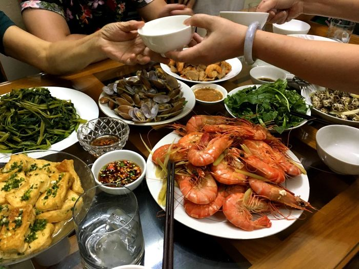 Vietnamese meal Vietnamese Food Vietnam Food And Drink Food Freshness Table Healthy Eating Plate Seafood Human Hand High Angle View Ready-to-eat Bowl Holding Meal Moments Of Happiness