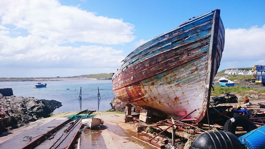 In for repair. Escaping Tranquil Scene Water Boatyard Scotland Islay Portnahaven Nautical Vessel Shipyard Sea