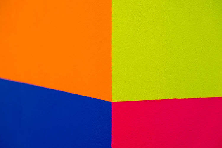 Abstract geometric pattern on concrete wall Art And Craft Equipment Backgrounds Blue Close-up Colored Background Copy Space Creativity Full Frame Green Color Indoors  Multi Colored No People Orange Color Paper Pattern Pink Color Red Saturated Color Studio Shot Textured  Wall - Building Feature Yellow