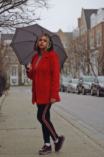 Red, 2019 One Person Full Length Architecture City Real People Young Adult Young Women Building Exterior Winter Clothing Women Lifestyles Built Structure Standing Leisure Activity Day Front View Casual Clothing Wet Warm Clothing Outdoors Rain Scarf Umbrella Toronto Canada Coat Street Fashion