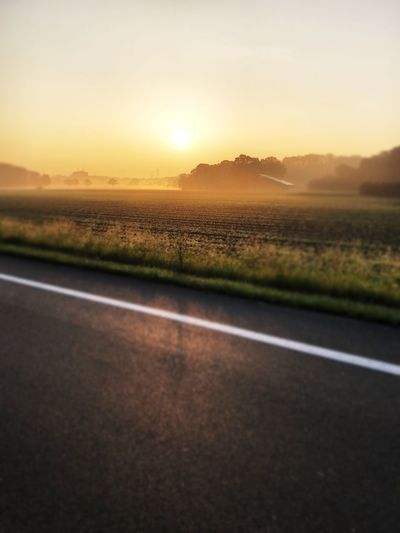 Sky Sunset Road Transportation Nature No People The Great Outdoors - 2018 EyeEm Awards Environment Tranquility Landscape Road Marking Sport Scenics - Nature Sun Beauty In Nature Tranquil Scene Land Field Plant Sunlight Outdoors