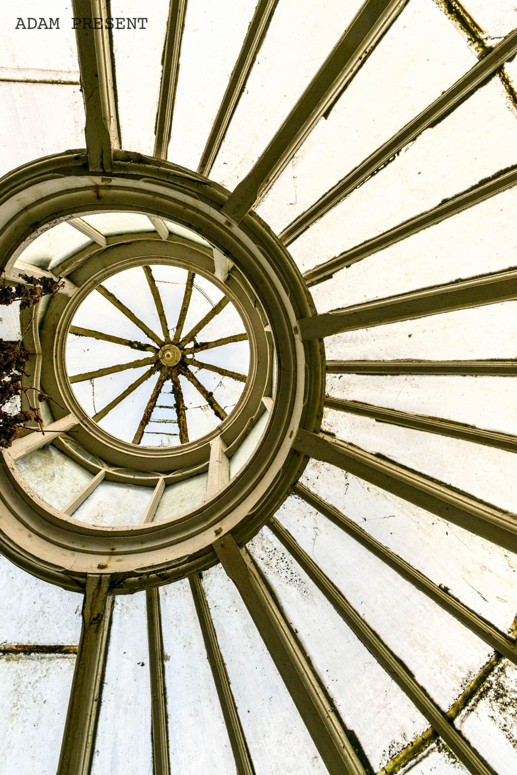 architecture, built structure, indoors, pattern, low angle view, design, directly below, ceiling, metal, geometric shape, architectural feature, spiral staircase, day, metallic, skylight, circle, no people, full frame, spiral, close-up