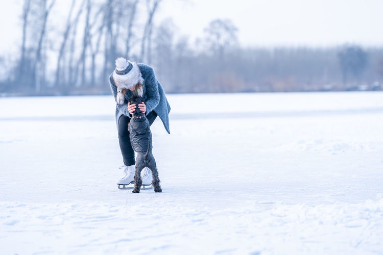 Full length of man on snowy field