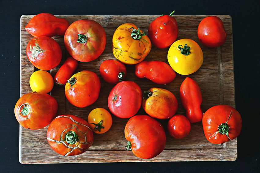 garden tomatoes Garden Tomatoes Close-up Directly Above Food Food And Drink Freshness Fruit Group Of Objects Healthy Eating High Angle View Indoors  Large Group Of Objects No People Orange Color Red Ripe Still Life Table Tomato Vegetable Wellbeing Wood - Material Raw Food Vitamin