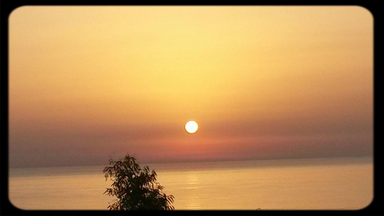scenics, sunset, beauty in nature, tranquil scene, tranquility, moon, nature, sun, sky, idyllic, sea, tree, horizon over water, outdoors, no people, astronomy, water, day