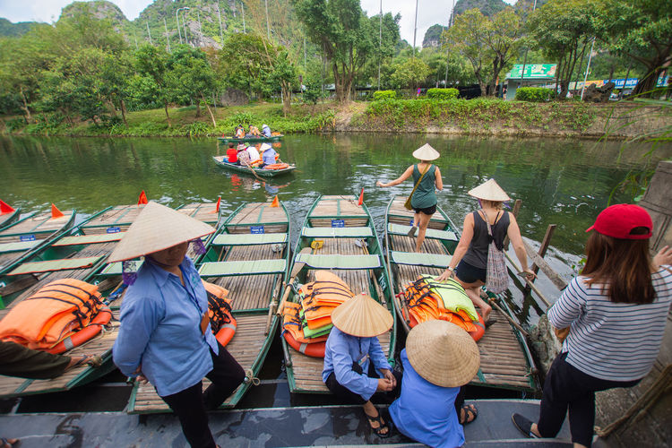 tourist sitting on boat at Trang An, Ninh Binh, Vietnam. Water Group Of People Real People Transportation Mode Of Transportation Nautical Vessel Men Group Tree Hat Nature Plant Lake Day Lifestyles Women Medium Group Of People People Outdoors