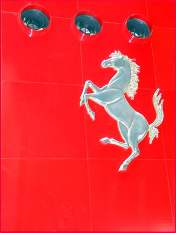 Ferrari Prancing Horse Day Full Length Indoors  Jumping Low Angle View Mid-air Red Silver