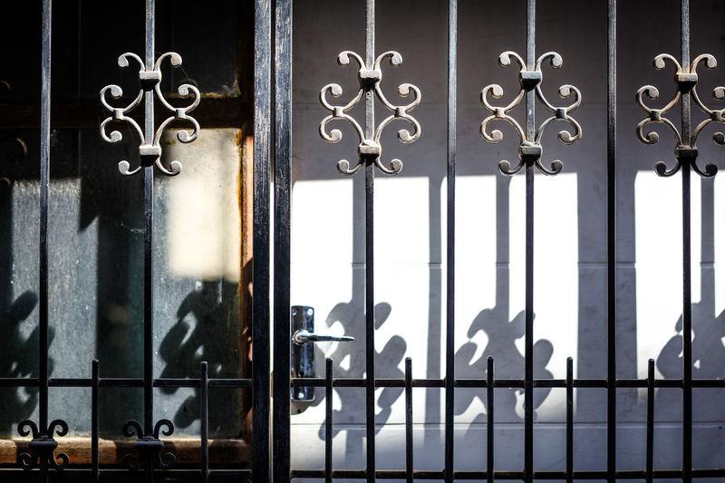 Close-up of metal grate at doorway