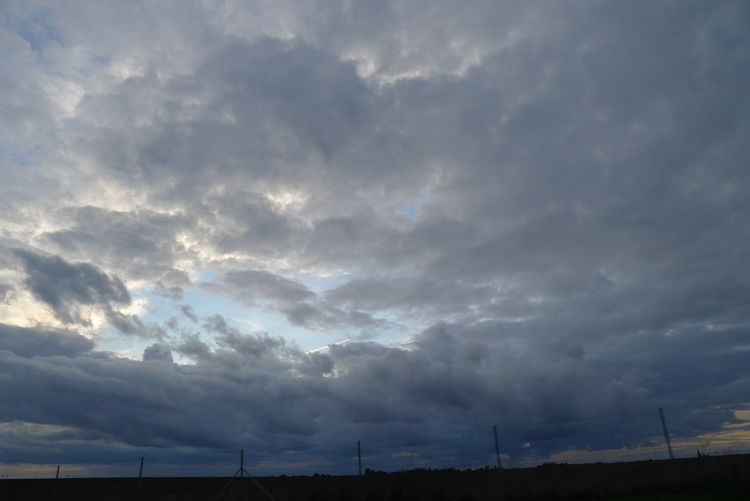 Low angle view of dramatic sky over landscape