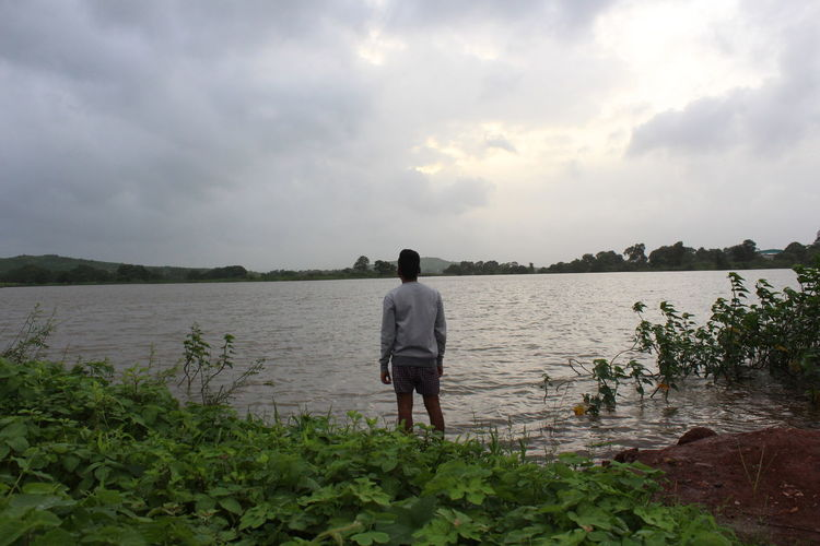 Rear View Lake Full Length Water One Person One Man Only Cloud - Sky Only Men Standing Nature Adult People Tranquility Adults Only Sky Day Men Outdoors Beauty In Nature Tree Low Angle View Connected By Travel Lost In The Landscape Beauty In Nature Its Me