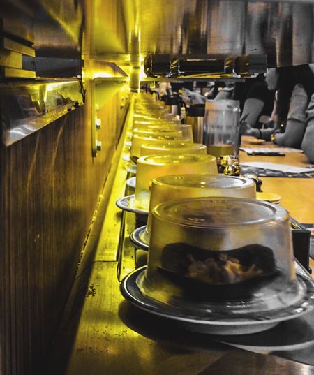 Paint The Town Yellow Shushi Restaurant Food And Drink Indoors  Machinery Commercial Kitchen Food And Drink Establishment Freshness iIlluminated cClose-updDayConveyer