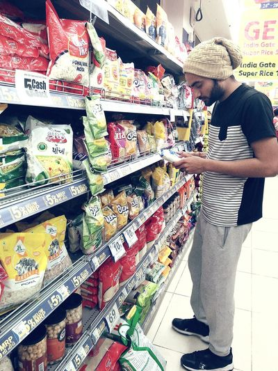 buy groceries Buying Groceries Grocery Shopping Groceryshopping Grocery Market Grocery Fun One Person Retail  Casual Clothing Food Choice Store Shelf Supermarket Indoors  Food And Drink Customer  Real People Consumerism Market Lifestyles Men Young Adult
