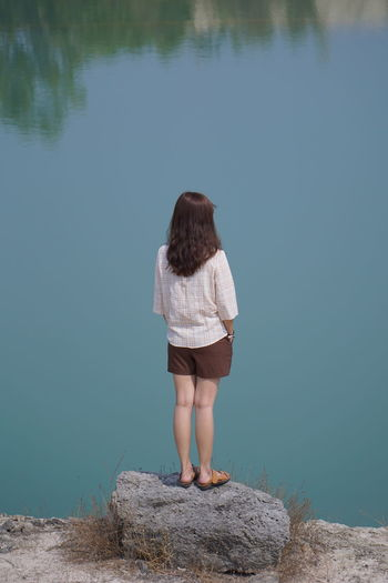 woman standing on rock