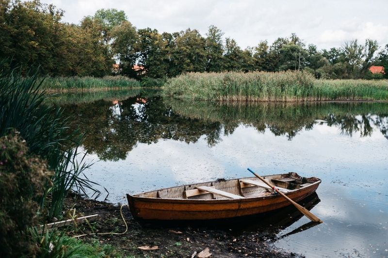 Ruderboot irgendwo auf dem Land Brandenburg EyeEm Best Edits EyeEmBestPics EyeEmNewHere EyeEm Best Shots Rowboat Water Nautical Vessel Reflection Mode Of Transportation Plant Transportation Lake Tree Nature Moored Day Tranquility No People Growth Beauty In Nature Sky Green Color Tranquil Scene Scenics - Nature Outdoors Capture Tomorrow 2018 In One Photograph