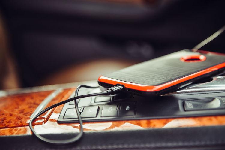 Close-Up Of Smart Phone In Car