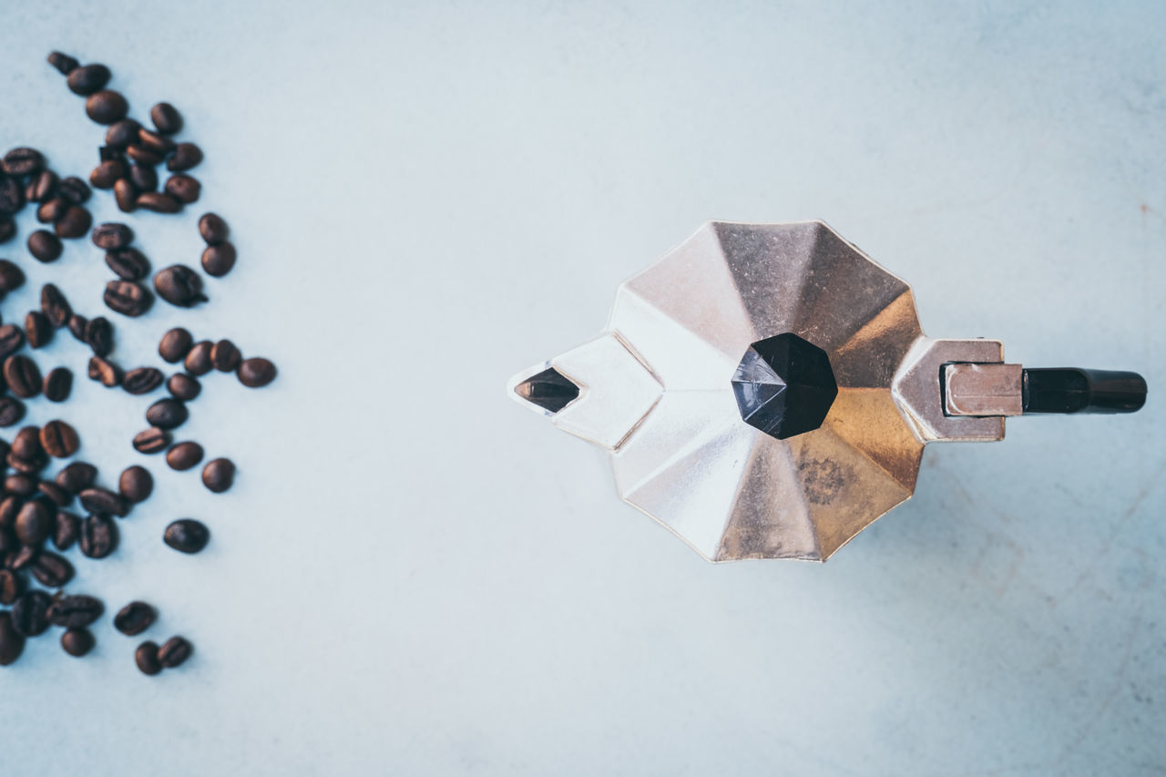 Directly Above Shot Of Espresso Maker With Roasted Beans On Table