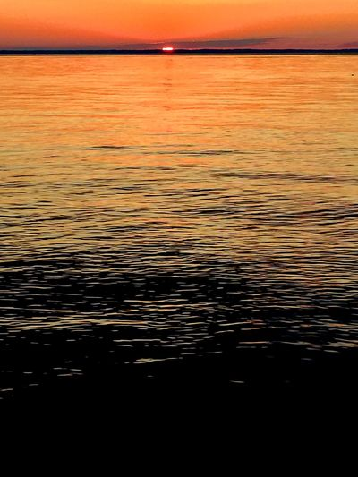 Sunset (Tilghman) Sunset Water Orange Color Rippled Sea Tranquility Close-up Tranquil Scene Scenics Water Surface Full Frame Seascape Nature Dramatic Sky Outdoors Beauty In Nature Vacations Back Lit Waterfront Wave Pattern Eastern Shore Of Maryland Long Goodbye