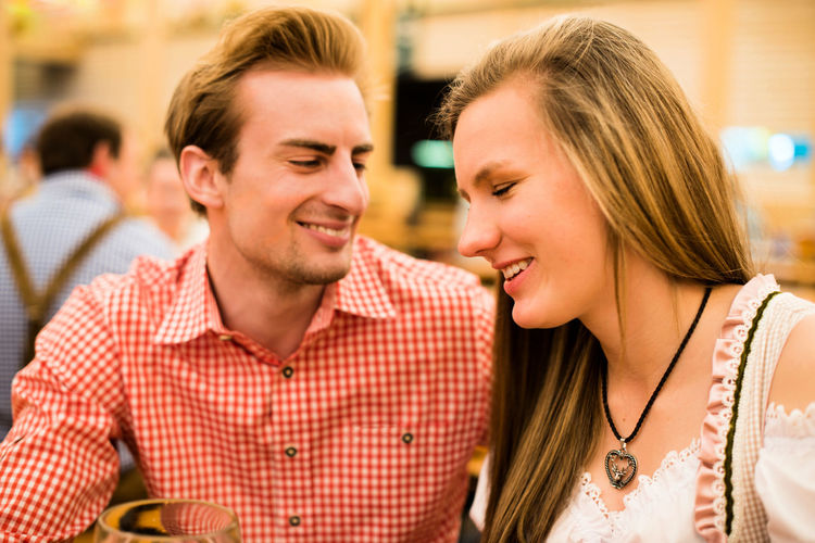 Smiling Young Couple At Restaurant