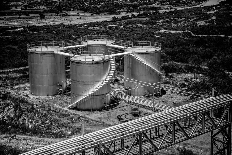 Tanques Guatemala 🇬🇹 Industrial Equipment Connection Technology Mode Of Transportation Storage Tank Outdoors Factory Tree Plant Built Structure Rail Transportation Fuel And Power Generation Architecture Day High Angle View Railroad Track Track Industry No People Motagua