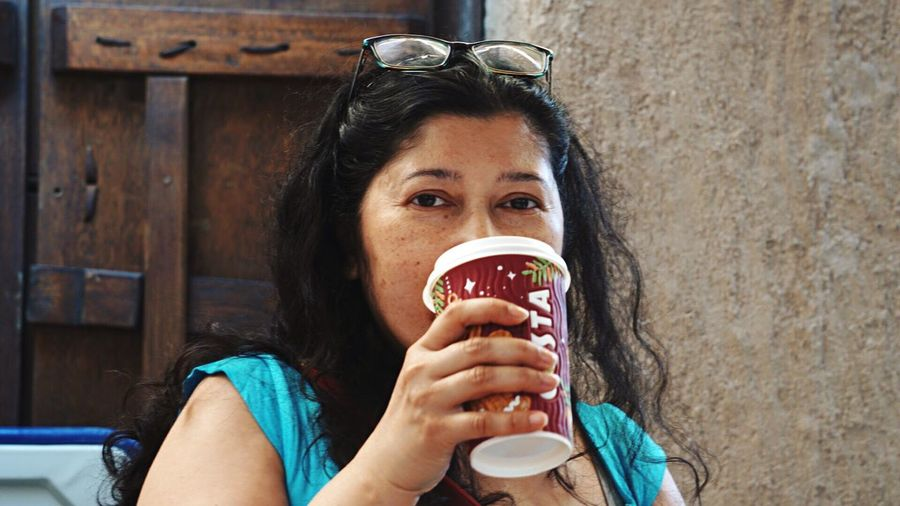 Coffee in old Dubai Drinking Drink Coffee - Drink Refreshment Food And Drink Portrait One Person Headshot Only Women Holding Adults Only Adult Looking At Camera People Outdoors Tea - Hot Drink One Woman Only Day Close-up Freshness Food Stories