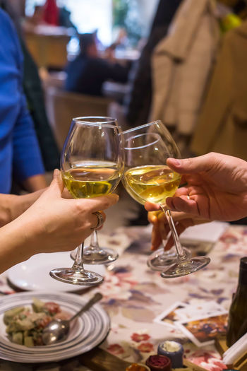 Drinking wine from beautiful glasses in a restaurant on a festive evening Wine Alcohol Wineglass Drink Refreshment Glass Food And Drink Drinking Glass Restaurant Cozy Celebration Event Family Family Time Four Cheers Happy Merry Good