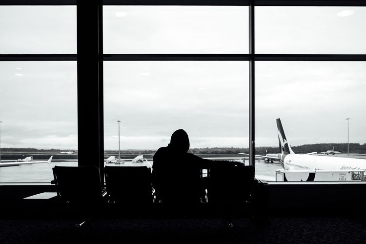 Waiting while travelling Airport Airport Waiting Airportphotography Airports Alone Black & White Black And White Blackandwhite Day Monochrome Silhouette Sitting Solitude Travel Photography Travelling Waiting