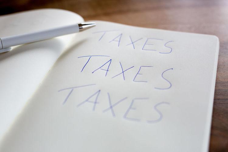 Taxes written in book