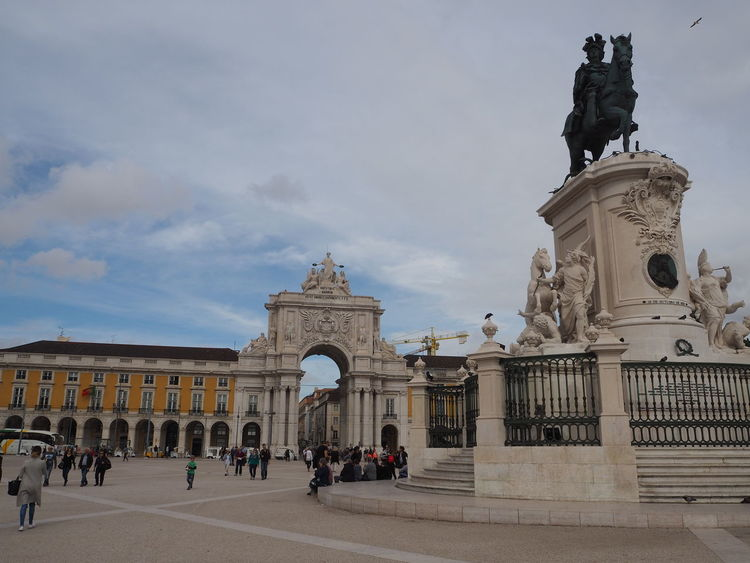 Praça do Comércio in Lisbon Architecture Praça Do Comércio Praça Do Comércio, Lisboa Sky And Clouds Travel Traveling Arch Architecture Art And Craft Building Exterior Built Structure City Day History Large Group Of People Lisbon Monument Outdoors People Real People Sculpture Sky Statue Tourism Travel Destinations