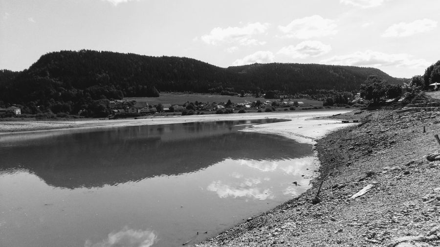 wave of heat... Waveofheat Heatwave Canicule Sécheresse Monochrome Landscape No People Blackandwhite Bnwphotography Water Mountain Lake Sand Reflection Sky Calm Countryside Tranquil Scene Rocky Mountains