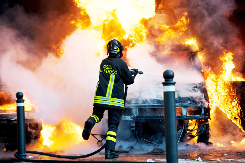 fire fighter extinguishing a fire during a demonstration against Berlusconi government in Piazza del Popolo Accidents And Disasters Against Berlusconi Government Burning Danger Demonstration Emergency Equipment Extinguishing Firefighter Heat - Temperature Piazza Del Popolo Protective Workwear Rescue Rescue Worker Rome, Italy Smoke - Physical Structure Resist The Photojournalist - 2018 EyeEm Awards
