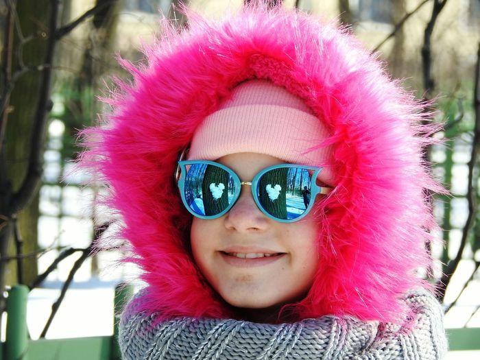 Portrait of smiling girls wearing fur coat