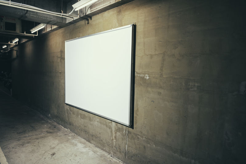 Blank Whiteboard On Wall In Parking Garage