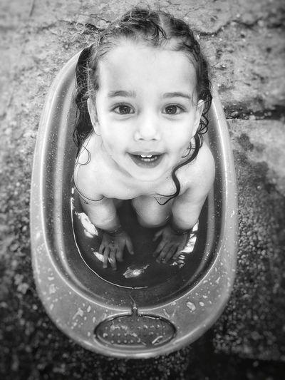 High angle portrait of cute baby girl sitting in bathtub