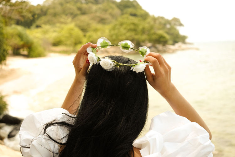 Flower Hairstyle Holding Human Hair Lifestyles Nature One Person Outdoors Wedding Ceremony Women