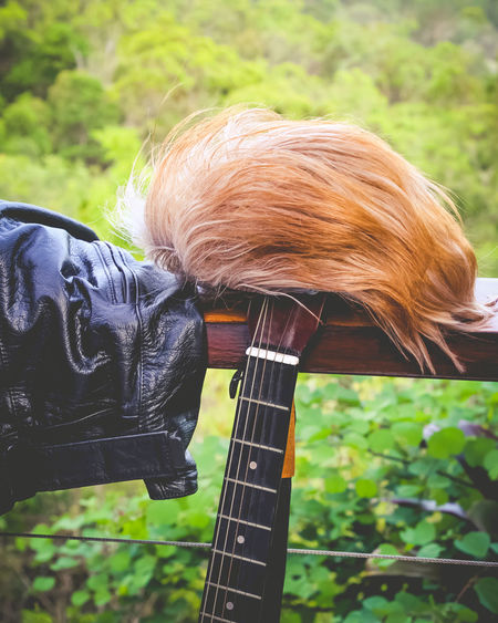 Music Close-up Day Field Focus On Foreground Green Color Guitar Hair Land Leather Jacket Musical Instrument Nature Outdoors Plant Rocknroll Wig
