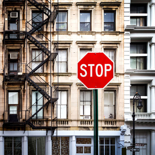 Stop sign on street in front of old vintage style buildings in Manhattan, New York City Apartment Architecture Building Building Exterior Historic Home Manhattan New York New York City No People NYC Road Road Sign Sign Stop Stop Sign Street Street Photography Streetphotography Text Transportation Travel Travel Destinations Vintage Window