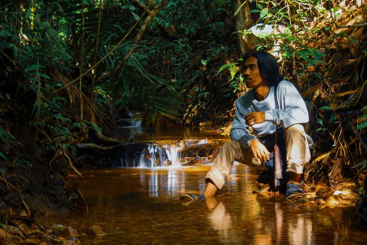 Photoshoot of a man in the tropical forest