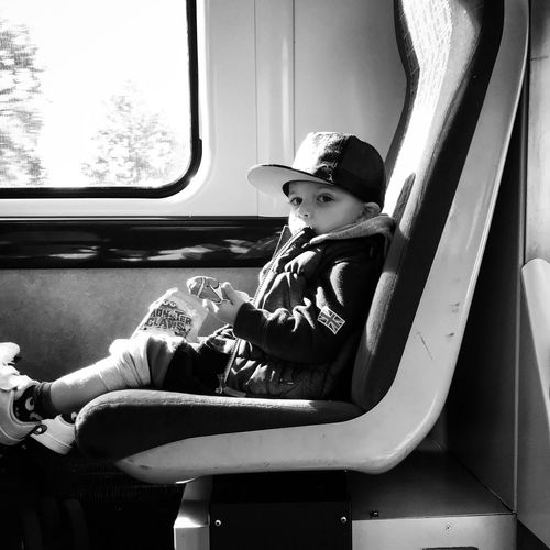 Train Journeys Blackandwhite Train Vehicle Interior Mode Of Transportation Window Transportation One Person Real People Day Travel Seat Sitting Public Transportation Childhood
