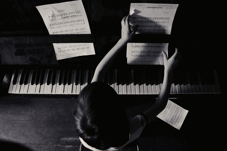 High Angle View Of Boy Playing Piano
